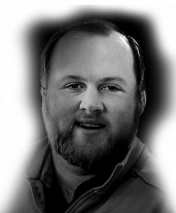Headshot of Rebel marketing specialist Andrew Hummel