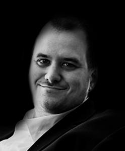 Headshot of Rebel digital project manager and developer Chris Dias